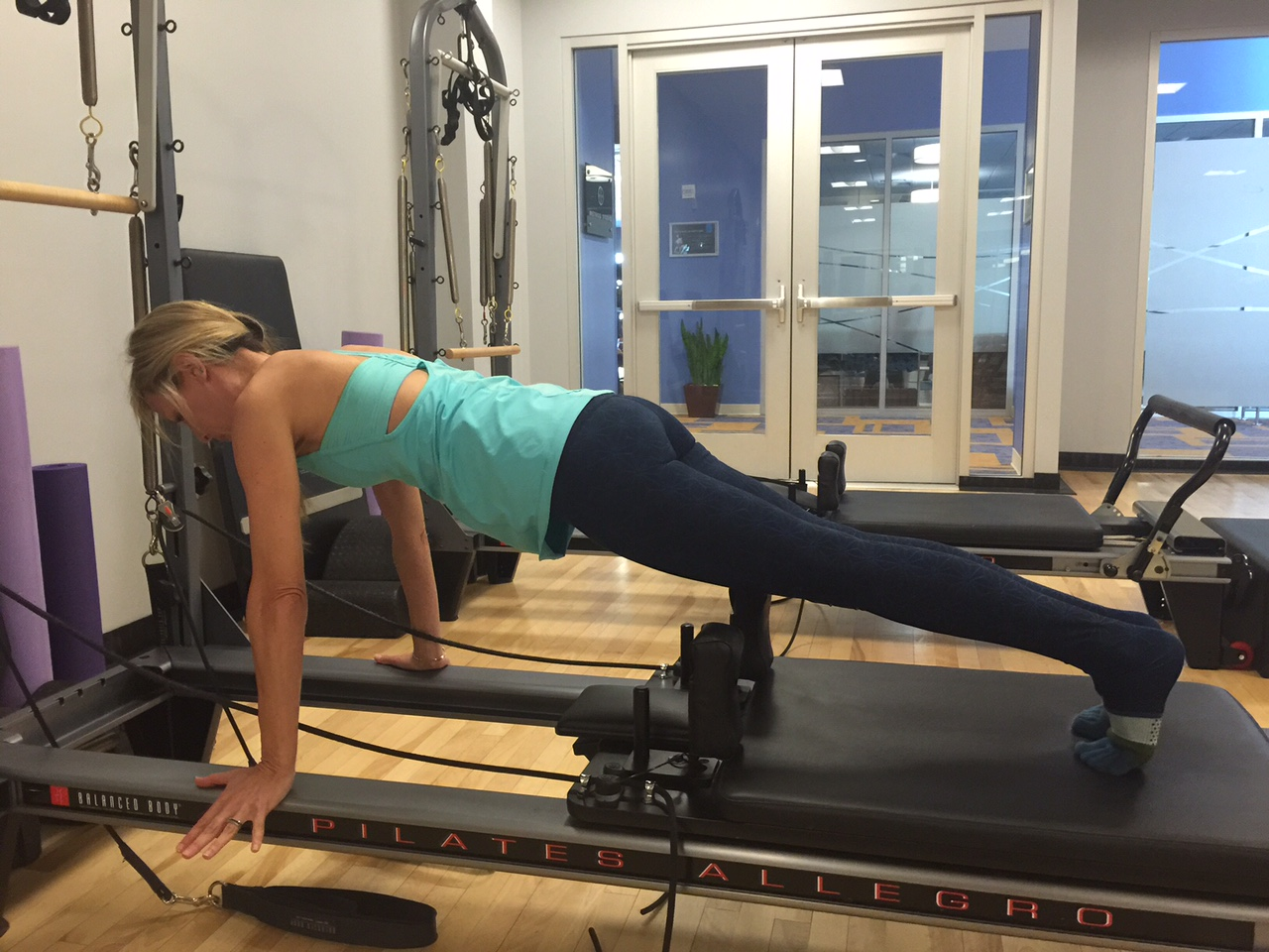 Pilates Reformer Is Good to the Core. Why I'm So Addicted.